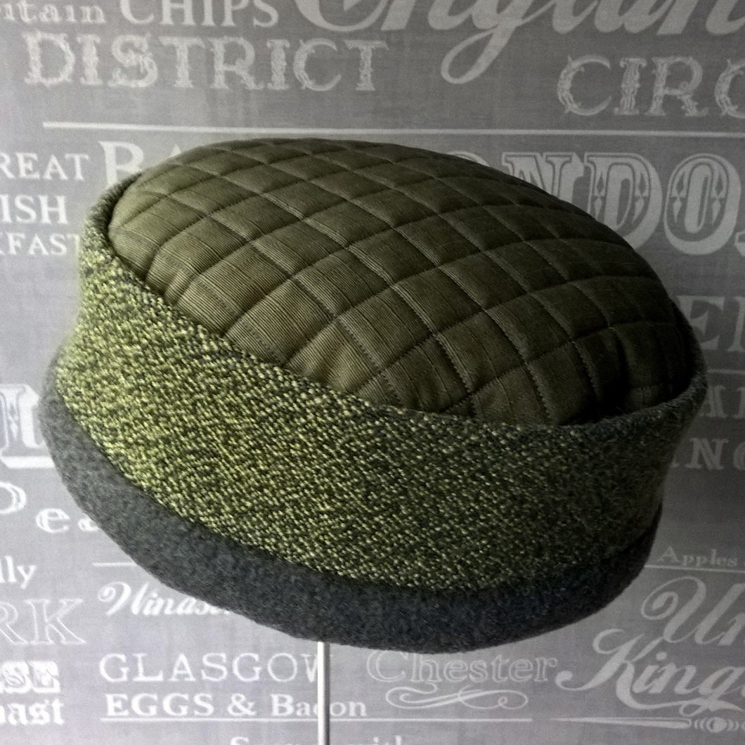 Green ethnic pillbox hat with winter fleece lining by TwiLd Capit Hog