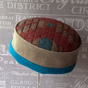 Multi coloured quilted fleece hat with an Aztec design by TwiLd Capit Hog