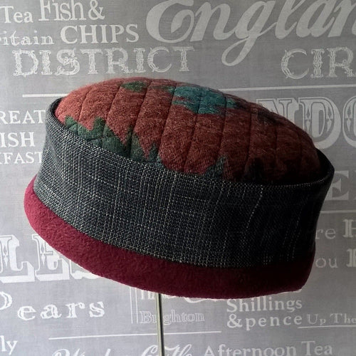 Fleece cap with multi coloured Aztec patterned tip and  grey cross-hatch patterned crown by TwiLd Capit Hog