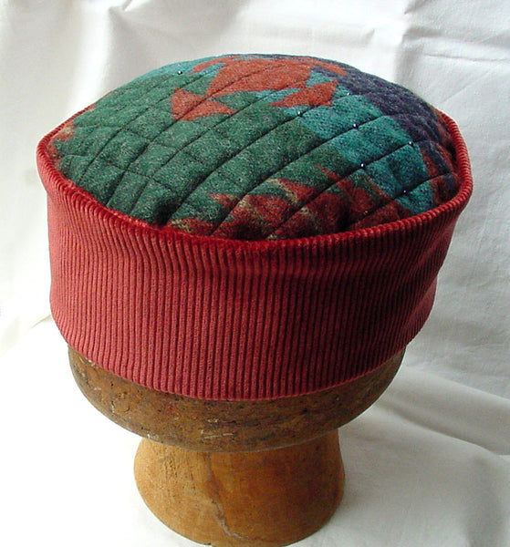 Handmade pillbox style smoking cap with an aztec pattern in red and green