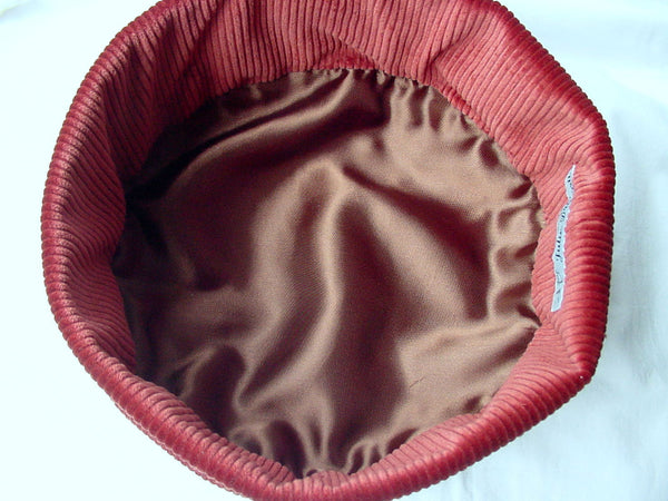 Inside the hat has a hand finished satin lining