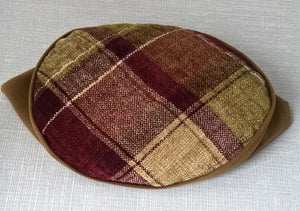 The tip of the handmade fez is quilted adding an extra design element