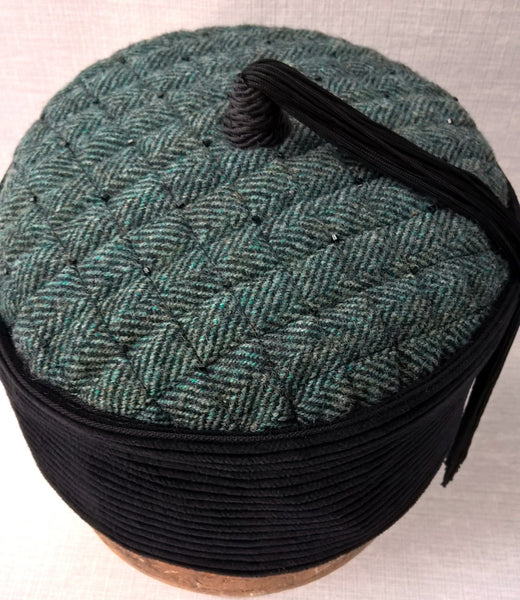 The tip of the smoking cap is quilted and hand-beaded in a distinctive TwiLd Capit Hog design