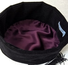 Load image into Gallery viewer, The interior of the smoking cap is hand-finished with a satin lining