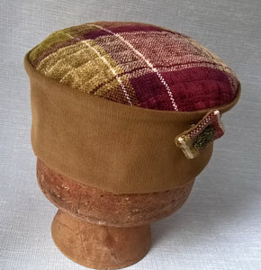The handmade Victorian style hat has a chenille tip and corduroy crown