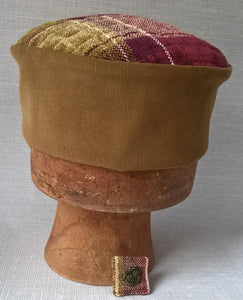 The pillbox shaped hat comes with a matching handmade brooch pin