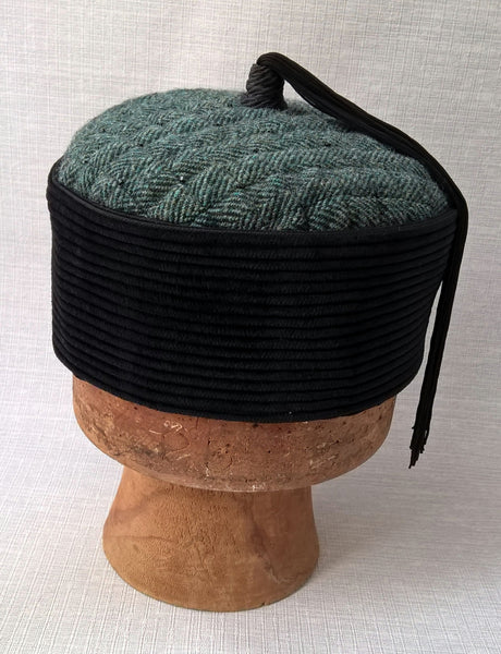 The crown of this fez is a luscious black corduroy