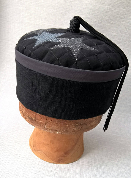 Front view of wizards tassel smoking cap in black and grey with applique stars