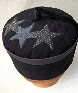 The smoking cap has a uniquely quilted and beaded tip with applique denim stars