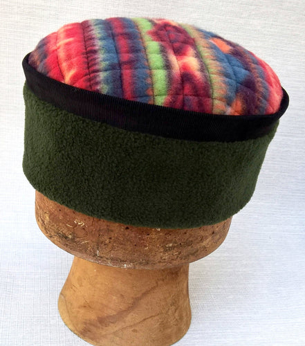 Fleece pillbox winter hat in a multi coloured tribal design
