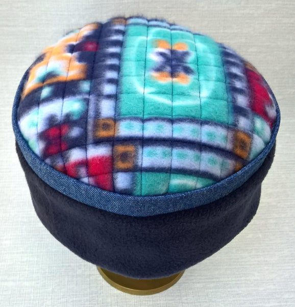 A vibrant multi colured aztec pattern tip makes this an eye catching winter hat by TwiLd Capit Hog
