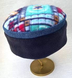 The navy and denim crown compliments the vibrant multi coloured tip of this fleece cap