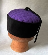 Load image into Gallery viewer, The purple lounge cap has a jet black corduroy crown
