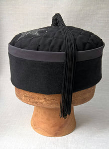 A beautiful tassel crafted from vintage black fringing completes this mens smoking cap
