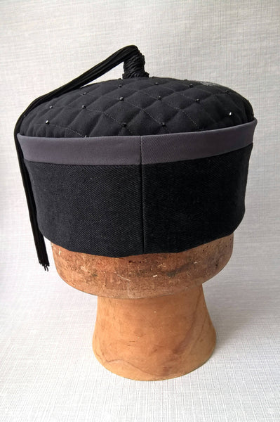 Back view of the wizards tassel smoking cap in black and grey with applique stars