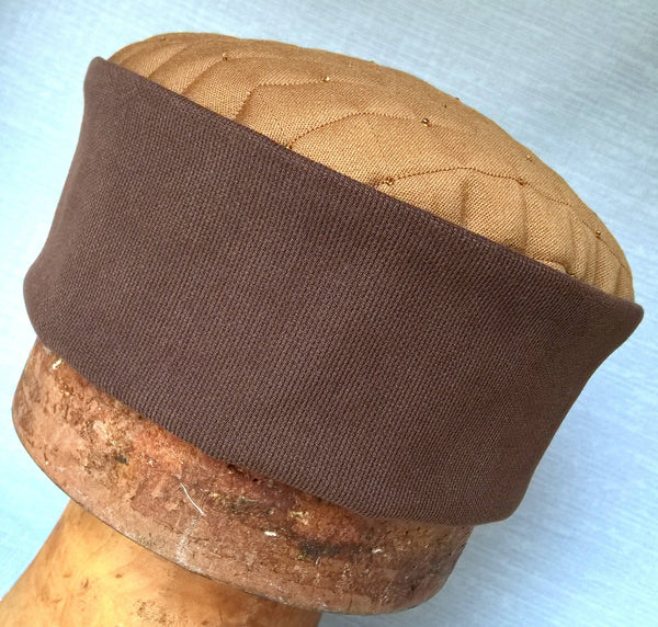 The smoking cap has a camel coloured tip and a dark brown crown