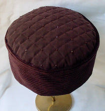 Load image into Gallery viewer, The handmade hat has a TwiLd Capit Hog signature quilted and beaded tip