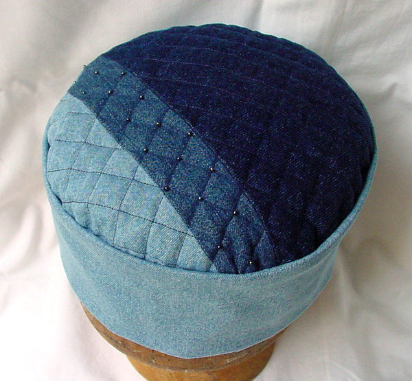 The tip of the hippie style kufi hat is patchworked in light stonewash, stonewash, and indigo denim