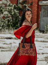 Juan-Antonio-Handcrafted-Hand-Tooled-Handbag-Carried-by-a-Beautiful-Woman-2003TL