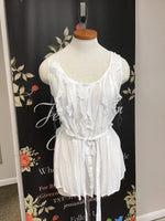 White sleeveless blouse/ ruffles