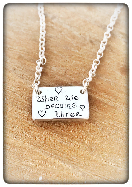 "*NEW* ""When we became Three"" Silver Pebble People Necklace"