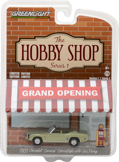 GreenLight 1/64 The Hobby Shop Series 1 - 1969 Chevy Camaro Convertible with Vintage Gas Pump Solid Pack - #97010-B