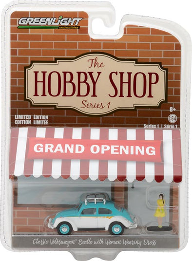 GreenLight 1/64 The Hobby Shop Series 1 - Classic Volkswagen Beetle with Roof Rack and Woman in Dress Solid Pack - #97010-F