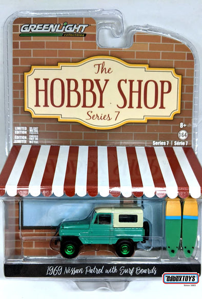 """GREEN MACHINE"" GreenLight 1/64 The Hobby Shop Series 7 - 1969 Nissan Patrol (60) with Surfboards Solid Pack - #97070-C"