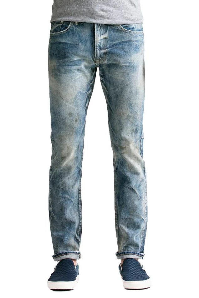 S.M.N Studio's Mercer in Coppola Men's Slim Fit Jeans - Light Vintage Indigo washed japanese cotton selvedge denim with fades honeycomb whiskering and paint/oil splatter effects