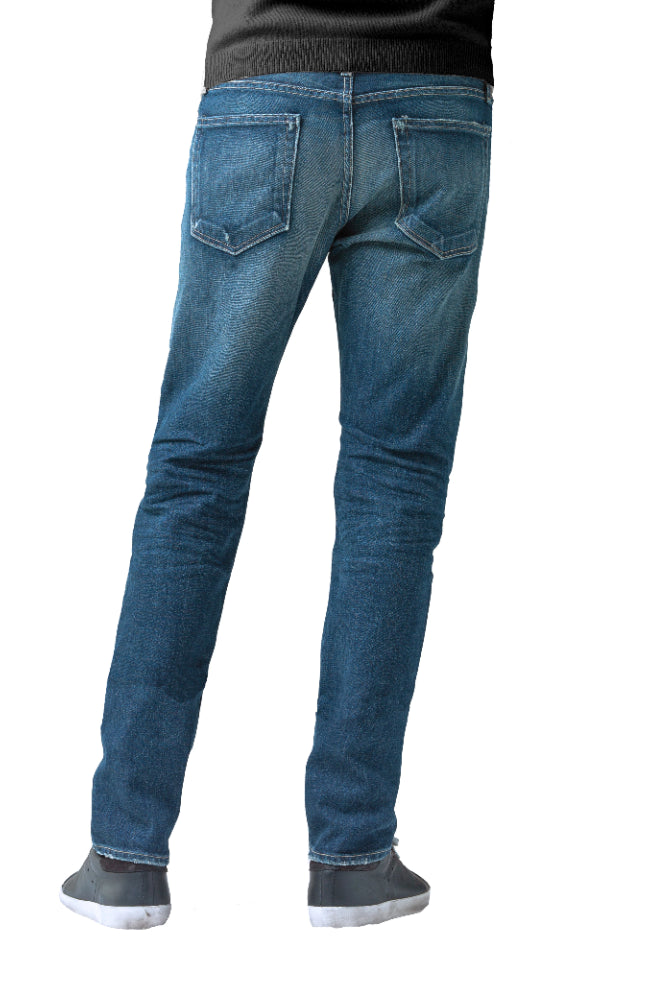 The back of S.M.N Studio's Hunter in Sundance Men's Jeans. A slim fit darker blue wash jean accented with contrasting fades and whiskers for a worn in look. It's made in a comfort stretch Japanese denim.