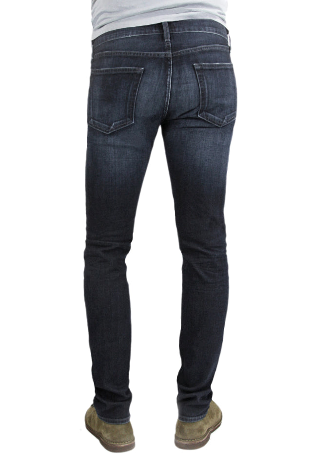 Back of S.M.N Studio's Finn in Cobalt Men's Jeans - Tapered slim fit jean in a dark indigo wash and comfort stretch premium Japanese denim. The light contrasting fades and 3D whiskering give it a lightly worn-in appeal