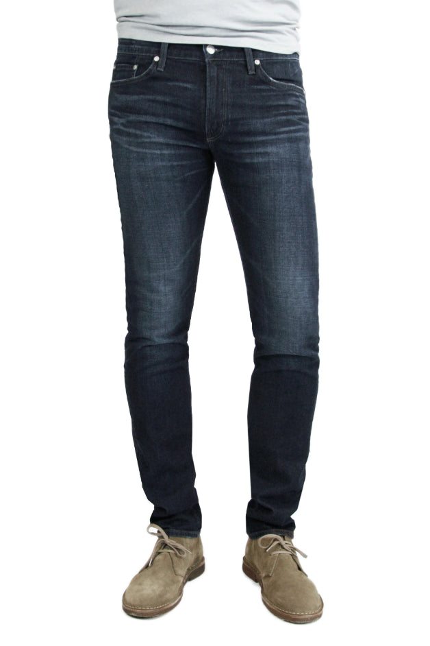 S.M.N Studio's Finn in Cobalt Men's Jeans - Tapered slim fit jean in a dark indigo wash and comfort stretch premium Japanese denim. The light contrasting fades and 3D whiskering give it a lightly worn-in appeal