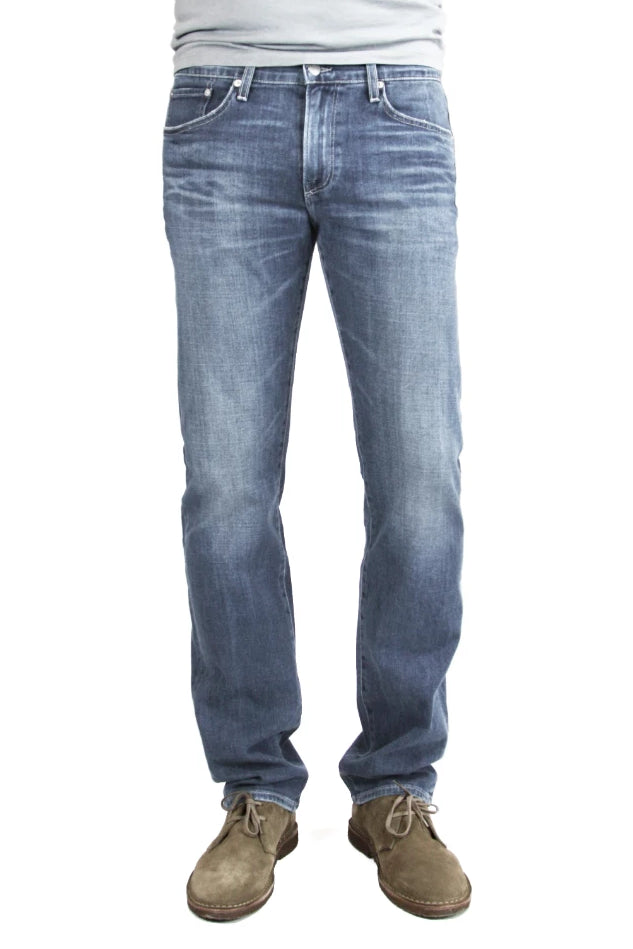 S.M.N Studio's Bond in Kai Men's Jeans. A slim straight jean in an extra soft lightweight comfort stretch Italian denim. The medium navy washed denim is contrasted with whiskers and fading.
