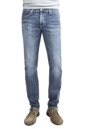 S.M.N Studio's Hunter in Kai Men's Jeans - A slim fit jean made up in a washed medium indigo color to create for a naturally worn-in casual and comfortable look with fading, honeycombs, and whiskering