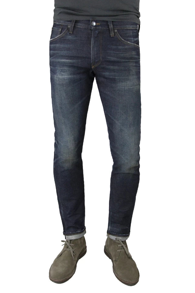 S.M.N Studio's Finn in Griffin Men's Jeans - Tapered slim jeans made in a premium stretch selvedge Japanese denim with a slightly worn-in raw denim wash