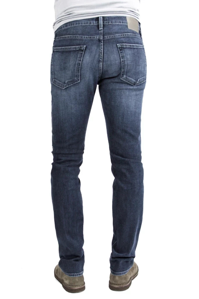 Back of S.M.N Studio's Hunter in Atlas Men's Jeans - Dark to medium indigo wash made up in a comfort stretch denim with light fading and 3D whiskering to create a broken-in look