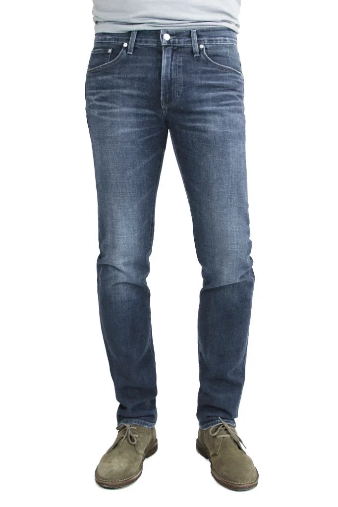S.M.N Studio's Hunter in Atlas Men's Jeans - Dark to medium indigo wash made up in a comfort stretch denim with light fading and 3D whiskering to create a broken-in look