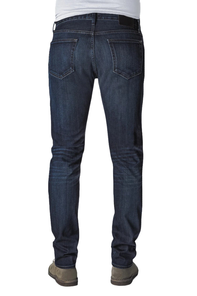 Back of S.M.N Studio's Hunter in Bowery Men's Jeans. Slim dark blue washed stretch jeans with lightly accenting contrast fades.