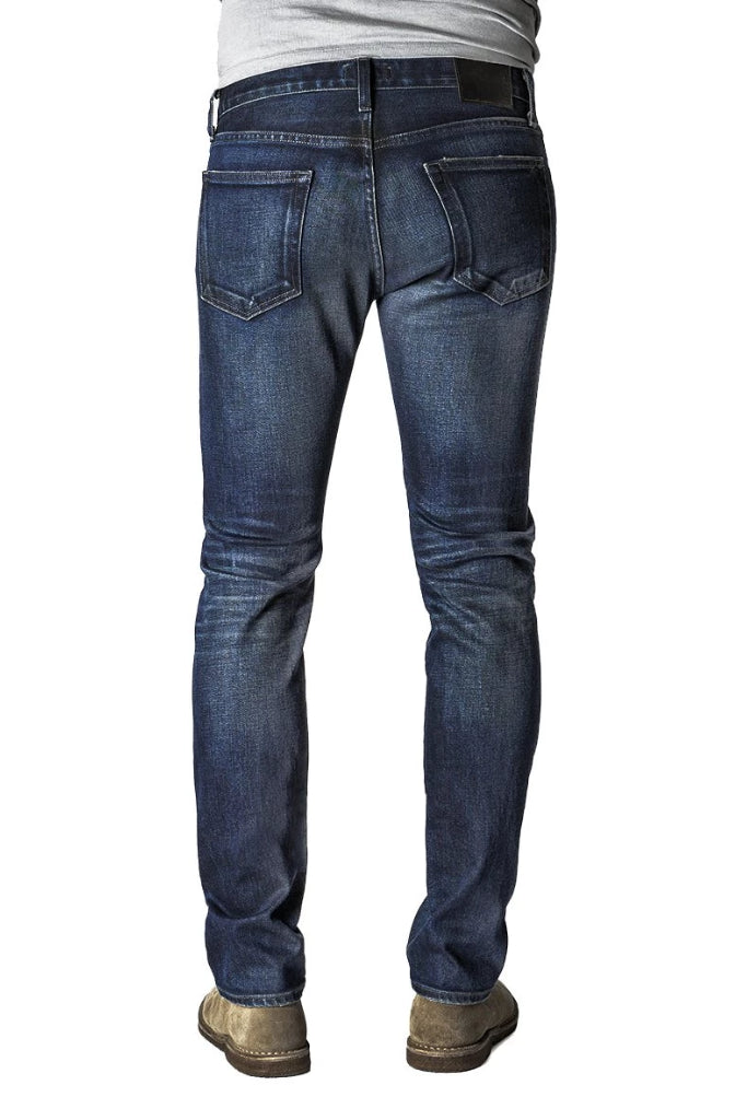 Back of S.M.N Studio's Hunter in Ethan Men's Jeans - Slim fit in a dark indigo washed Japanese premium stretch selvedge denim and light contrast fading and whisker for a vintage appeal