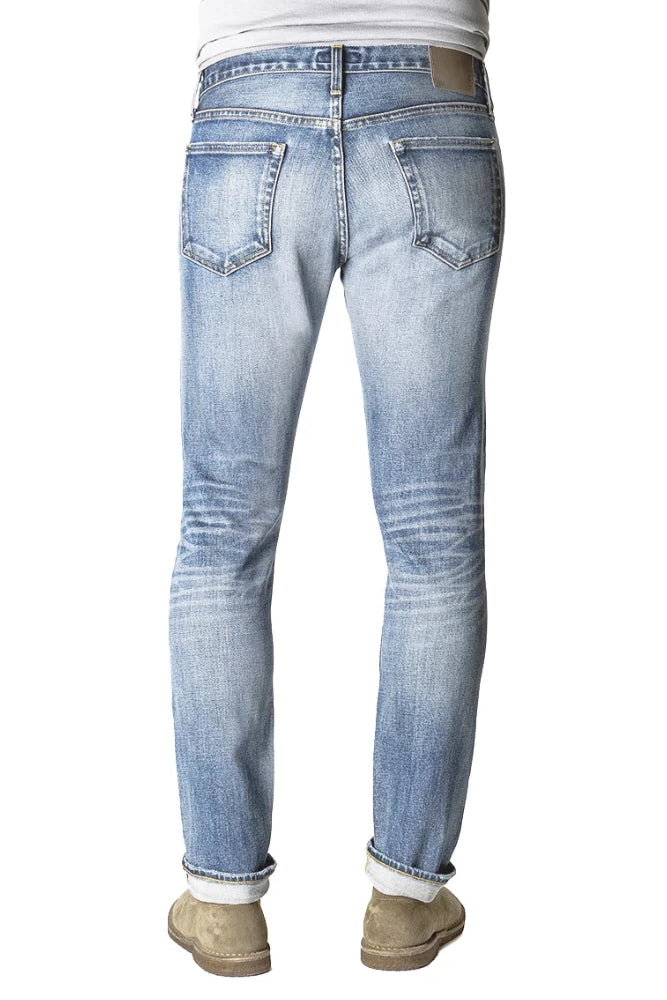 Back of S.M.N Studio's Hunter in Phoenix - Men's slim fit light vintage indigo washed stretch selvedge denim with fading and whiskering
