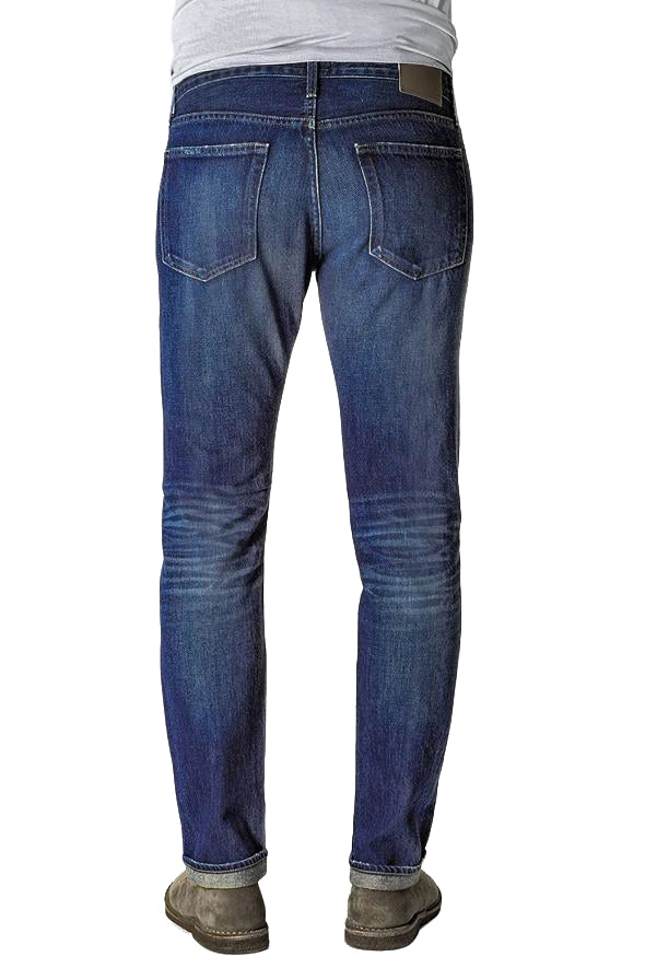 Back of S.M.N Studio's Hunter in Rainer Men's Jeans - 100% Cotton Selvedge Slim fit jean made in a dark indigo wash contrasted with light fades, honeycombs, whiskers, and slight tear details