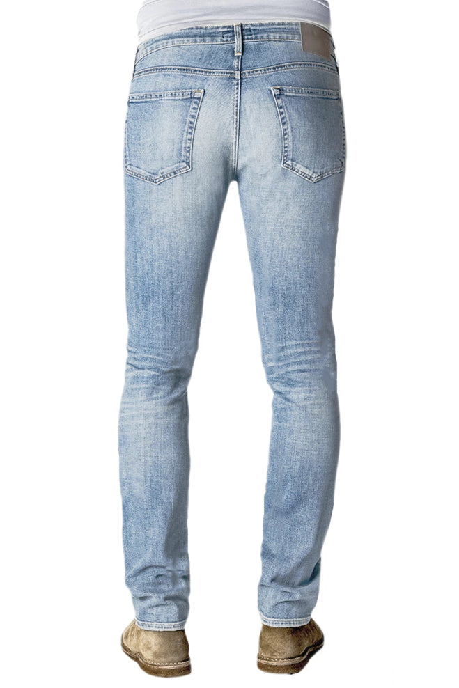 Back of S.M.N Studios' Hunter in Sunset Men's Jeans. A slim fit denim made in a comfortable stretch fabric and a light vintage denim wash