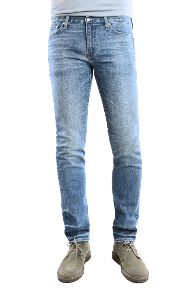 S.M.N Studio's Finn in Maison Men's Jeans - Tapered Slim Light blue comfort stretch premium denim with whiskering and fades for a natural lived in wash