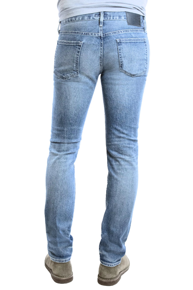 Back of S.M.N Studio's Finn in Maison Men's Jeans - Tapered Slim Light blue comfort stretch premium denim with whiskering and fades for a natural lived in wash