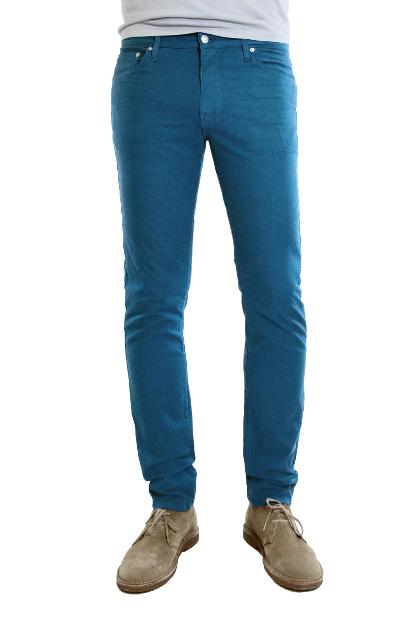 S.M.N Studio's Hunter in Marine Men's Twill Pants. A slim stretch comfort twill pant in a teal color