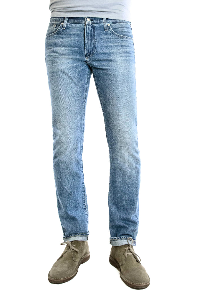 S.M.N Studio's Hunter in Mayfair Men's Jeans. A comfortable stretch selvedge light wash Japanese denim finished with fades, honeycombs, and whiskering