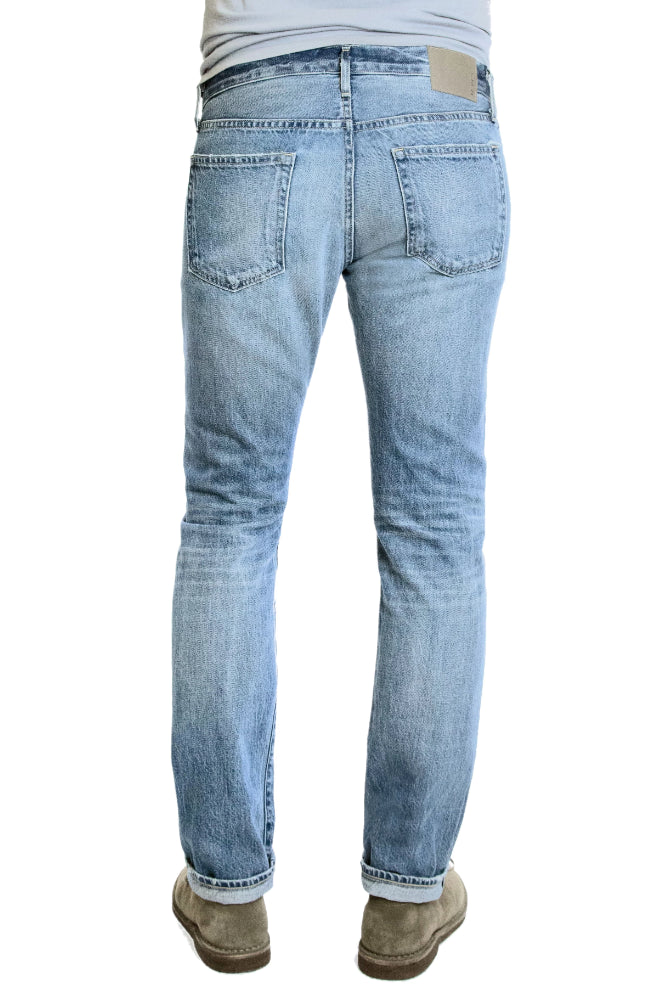 Back of S.M.N Studio's Hunter in Mayfair Men's Jeans. A comfortable stretch selvedge light wash Japanese denim finished with fades, honeycombs, and whiskering