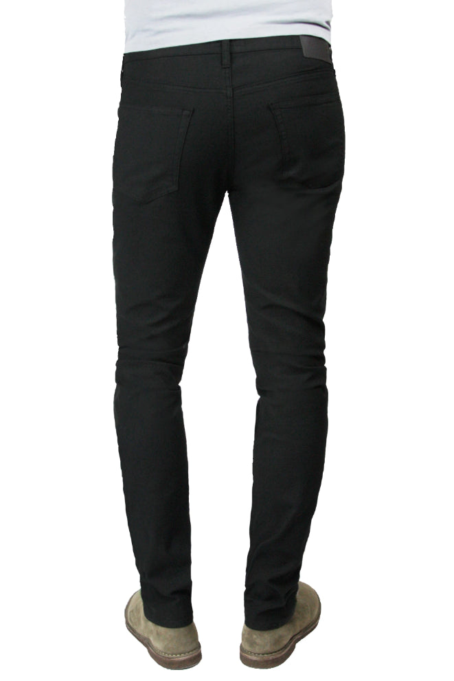 Back of S.M.N Studio's Finn in Black Men's Twill pants. Tapered slim comfort stretch twill pants dyed in black