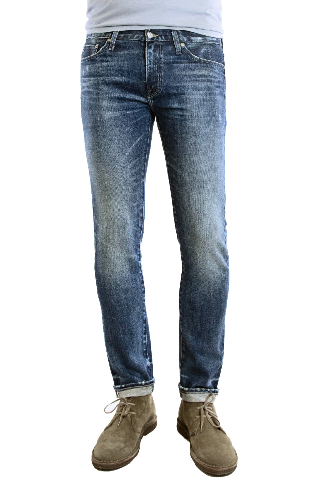 S.M.N Studio's Hunter in Prospect - Men's slim fit stretch selvedge jeans in a medium dark indigo vintage wash with contrasting fades and slight distressing