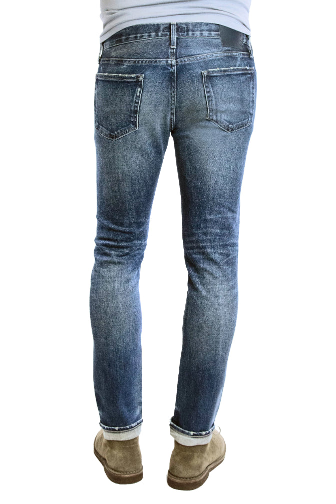 Back of S.M.N Studio's Hunter in Prospect - Men's slim fit stretch selvedge jeans in a medium dark indigo vintage wash with contrasting fades and slight distressing